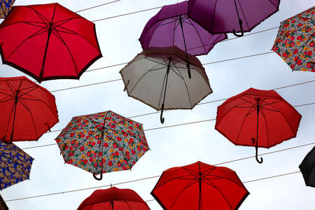 spanned: lot of colorful umbrellas in the sky