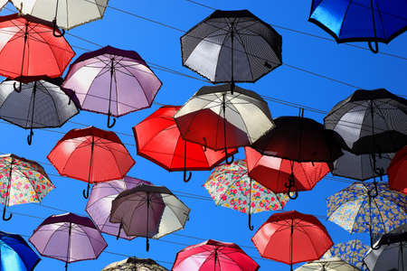 spanned: a lot of colorful umbrellas in the sky Stock Photo