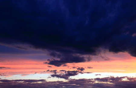 afterglow: coming rain clouds in the afterglow sky
