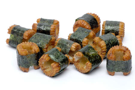 fishy: Sushi-shaped, small pastry pieces, wrapped with seaweed, seaweed, and a strong fishy taste Stock Photo