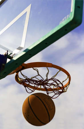 Trying to get back the basketball after a unsuccessful shot. photo