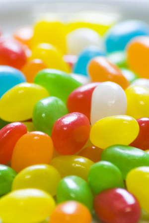 Many colourful halloween candy filling background. photo