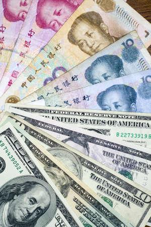 rmb: Chinese currency yuan and U.S. dollars amerkinaische bills