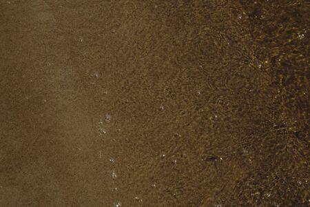 Tide, sand, water border