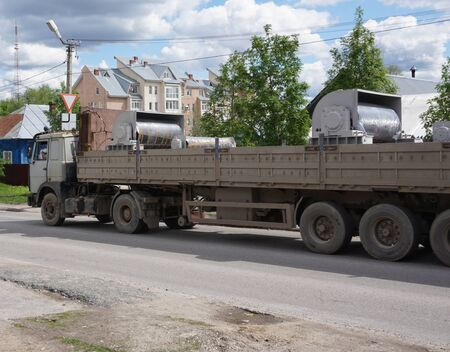 long semi-trailer with an open top truck cargo