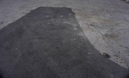 コンクリート アスファルト舗装パッチ地面修復舗装道路の駐車場で