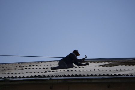 worker repairing a roof Stock Photo
