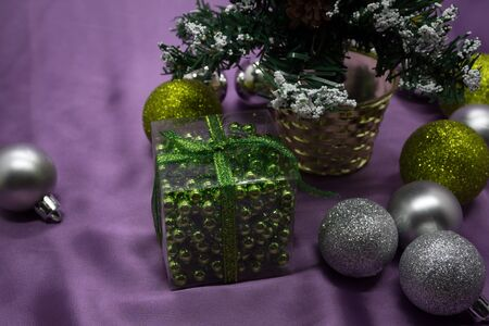 Christmas tree with gifts on purple background. Stock Photo