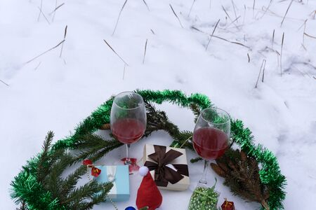 Still life with glass and wine in front of the tree Фото со стока