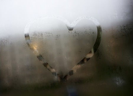Autumn rain, the inscription on the sweaty glass - love and heart