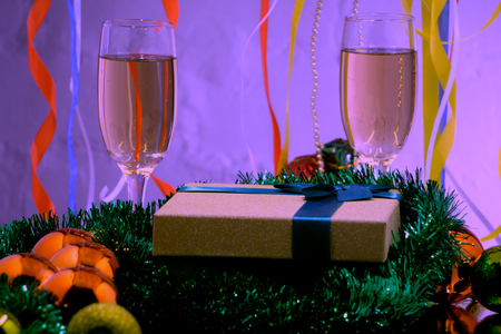 The celebration of Christmas and the New year with champagne. Christmas holiday decorated table.