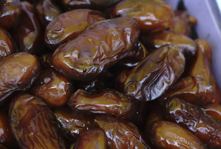 Bowl of pitted dates , top view Stock Photo