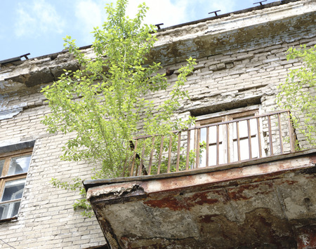 Settled crumbling buildings with broken Windows