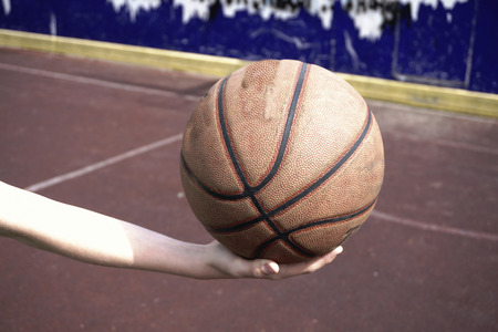 Basketball ball in hand Stock Photo