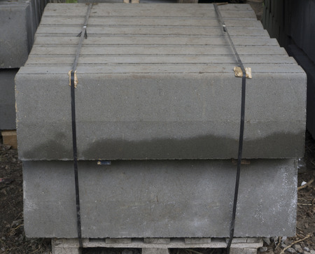 Stack of concrete curbstone. Construction process Foto de archivo