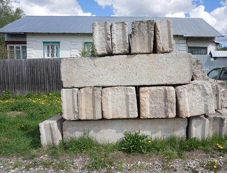 stack of concrete blocks, construction site against a blue sky
