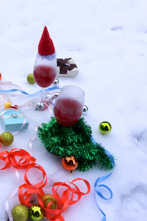 Christmas wine , candles and traditional Christmas decorations and orange on a light background