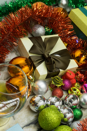 Festive Christmas and New year background Wallpapers or cards . Christmas tinsel, decorations, gifts, and other attributes of the holiday on a brown wooden surface