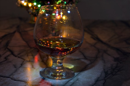 a glass of whiskey and Christmas tree ,