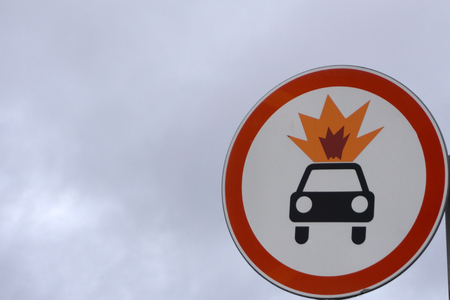 Old warning sign on vehicle with tank for flammable liquid background. Transportation of flammable and combustible liquids. Color effect Stock Photo