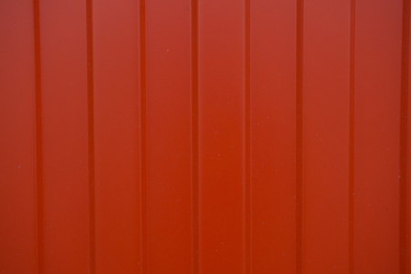 Red ribbed and corrugated sheet roof coverings