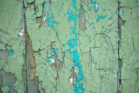 Wooden texture with peeling paint. Wooden surface with flaking paint. Old wooden background Banque d'images - 94451780
