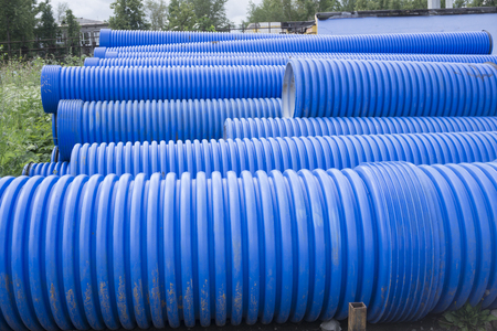 Blue corrugated pipe for electrical high-voltage cables isolated on white background Stock Photo
