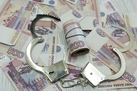 handcuffs on the background of banknotes Banco de Imagens