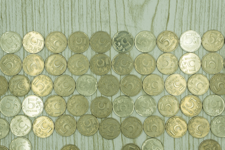 Pile of US coins with copy space above Horizontal.