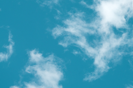 small clouds in the blue sky. Evening sky with lots small clouds - natural background Stock Photo