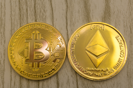 horizontal top view closeup of ethereum litecoin and bitcoin stack of golden coins background texture exchange concept Foto de archivo