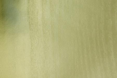 Grunge textured background torn worn yellow yellowed 写真素材
