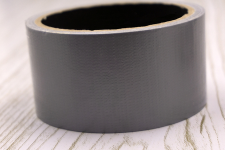 Tape for padding, insulation, the forming of panels, high initial adhesion, aluminium adhesive tape represents aluminium foil with acrylic adhesive coating Stock Photo
