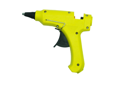 Hand holding glue gun isolated on the white background 写真素材