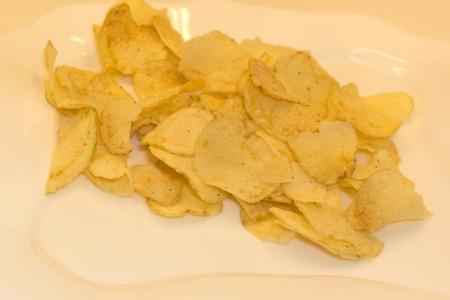 Set of potato chips heaps on a white background Standard-Bild