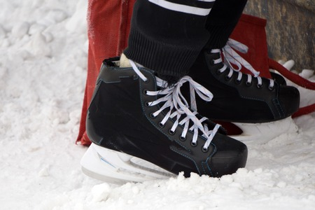 Mens hockey skates on a white background