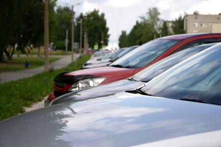Colorful Cars Stock Cars For Sale. Dealer Lot Cars Row. Standard-Bild