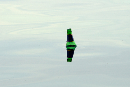 Old bottles floating in the water space toxic