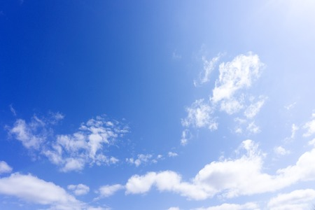 blue sky with white, soft clouds fresh .