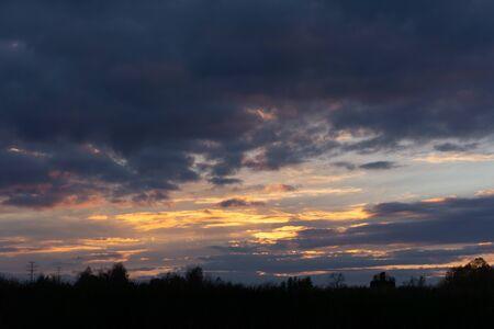 sunset over river sunrays twilight yellow mountain