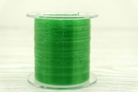 roll of nylon fishing line in color background . Фото со стока