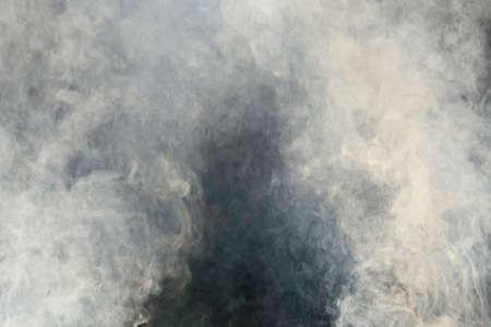 Photograph of white smoke on black background, Photo with space for advertising, blank space for your promotional text or advertising content, horizontal photo