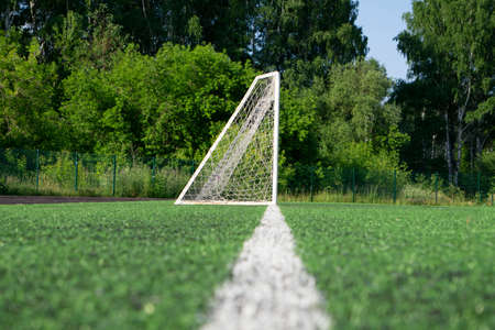 Goal with net stand on a soccer or football field