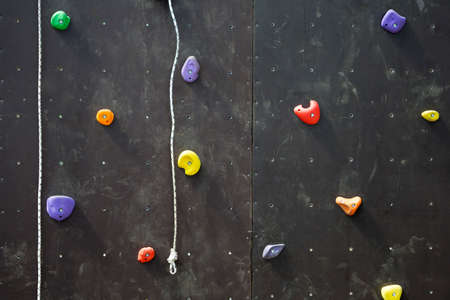 Climbing gym. Colorful footholds for training active