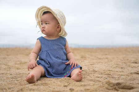 asian baby on the beach