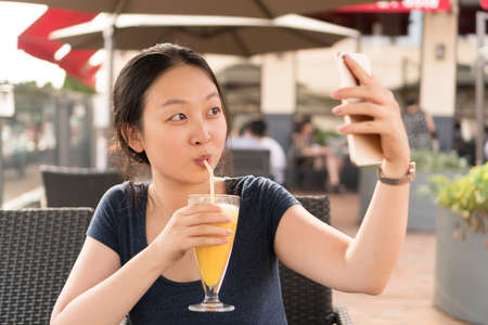 dimple: Chinese girl in cafe Stock Photo