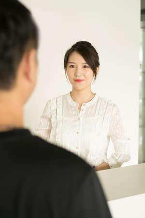 office lady looking into the mirror Banco de Imagens