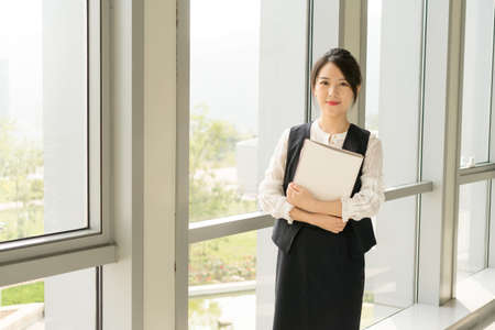 office lady holding a document
