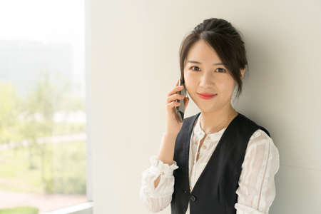 office lady talking on the phone