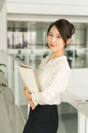 office lady holding documents Banco de Imagens